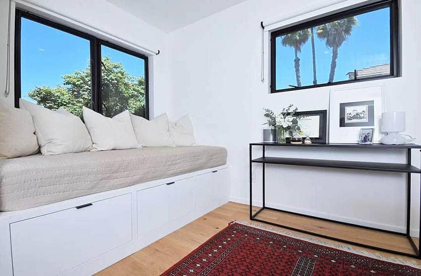 Built in window seat bed in guest bedroom