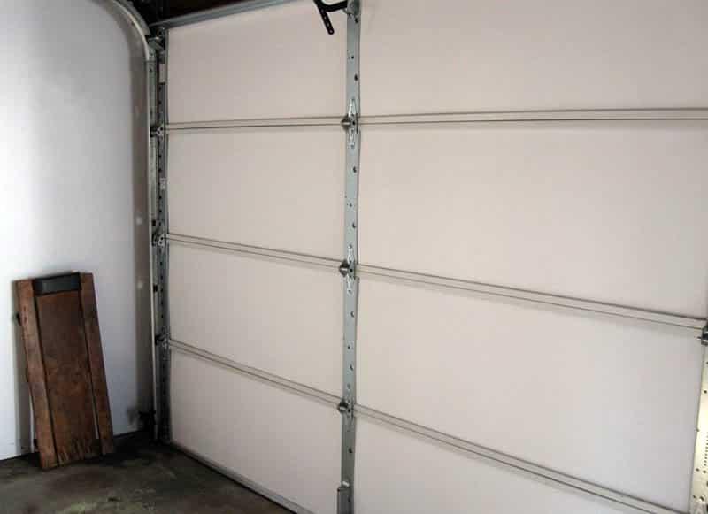 Insulated garage door panels