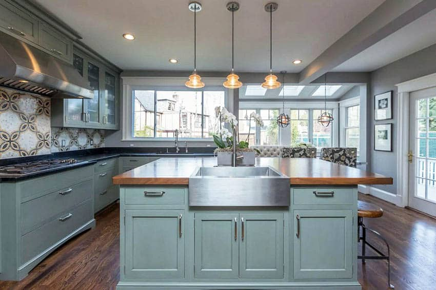 Kitchen with green cabinets and flush door hinges