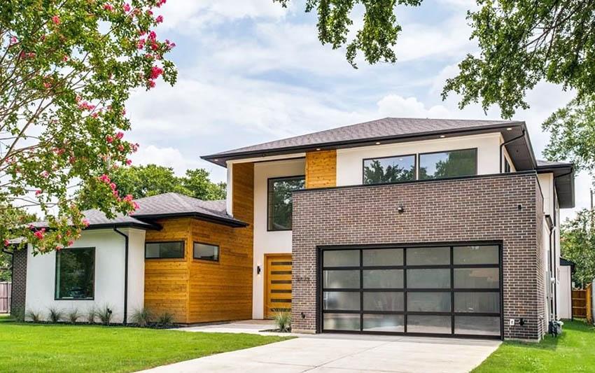 Modern home with glass garage door
