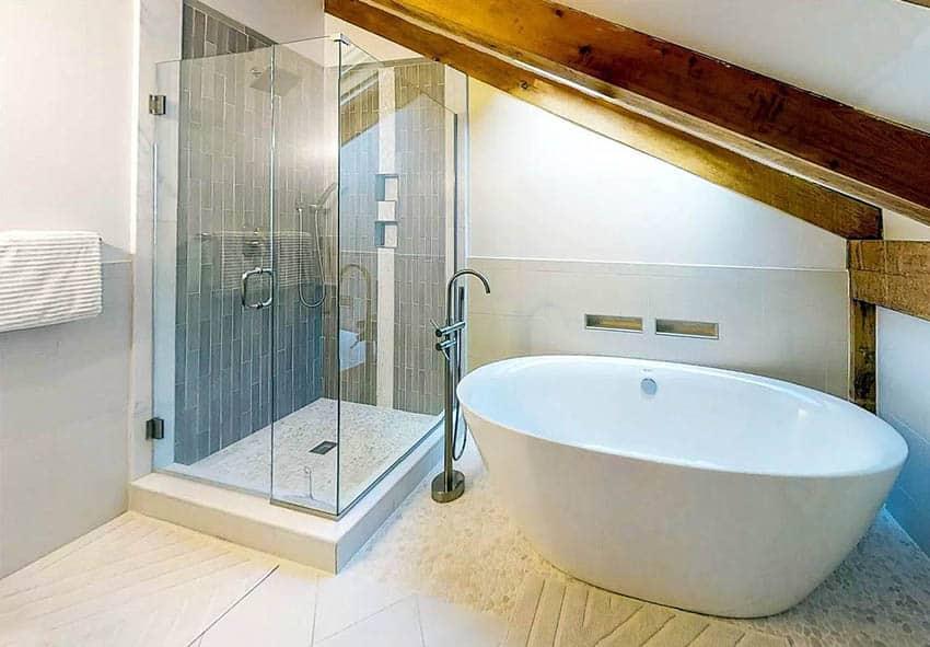Attic bathroom shower with java pebble tile