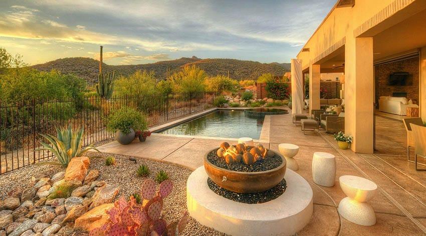 Backyard with desert plants with lighting
