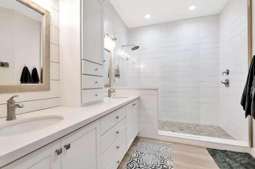 Bathroom with walk in shower and wood look tile floor