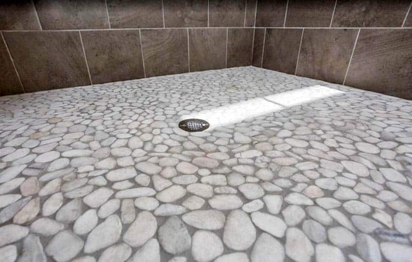 Flat pebble tile in shower