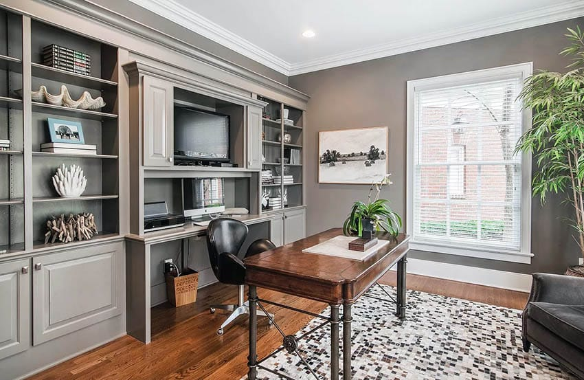 Home office with built in desk and bookshelves with stand alone desk