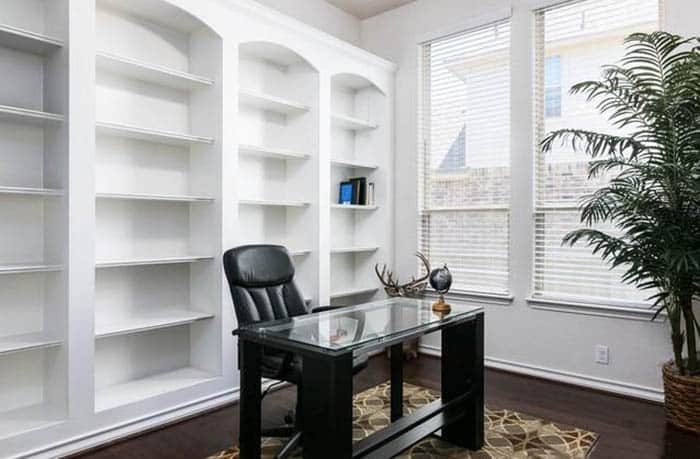 Home office with built in shelving