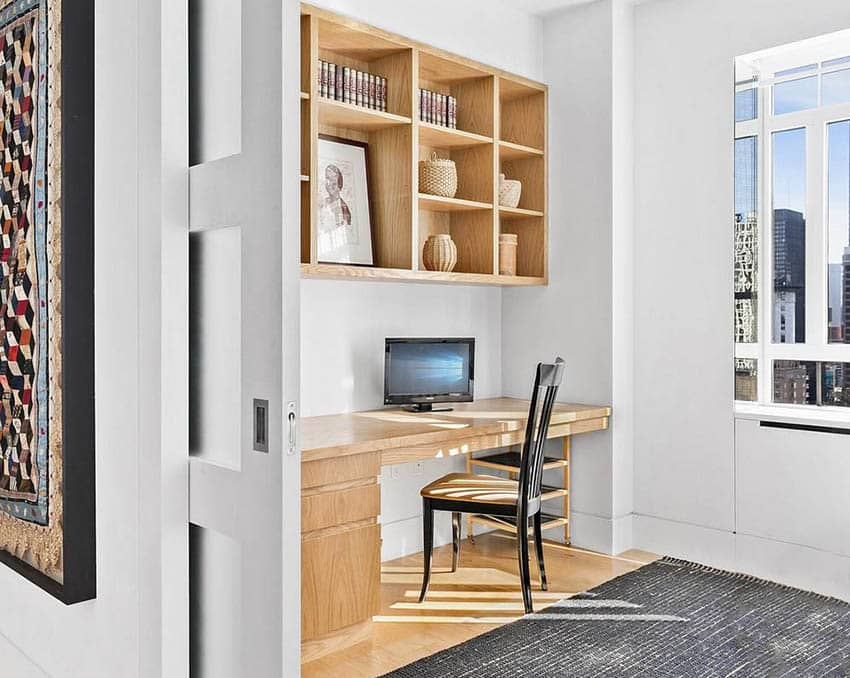 Home office with diy built in desk and shelving