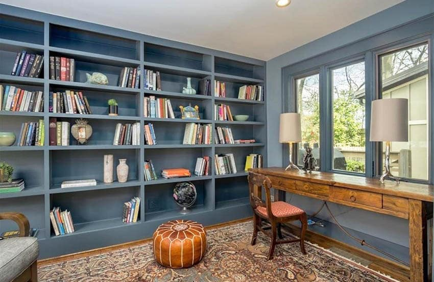 Home office with gray built in shelving
