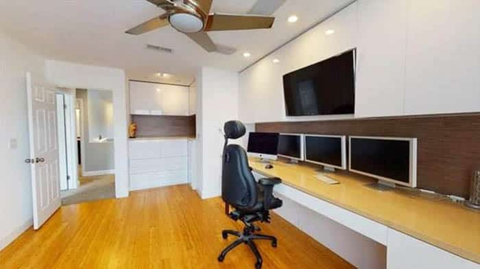 Office room with modern built in desk and cabinet