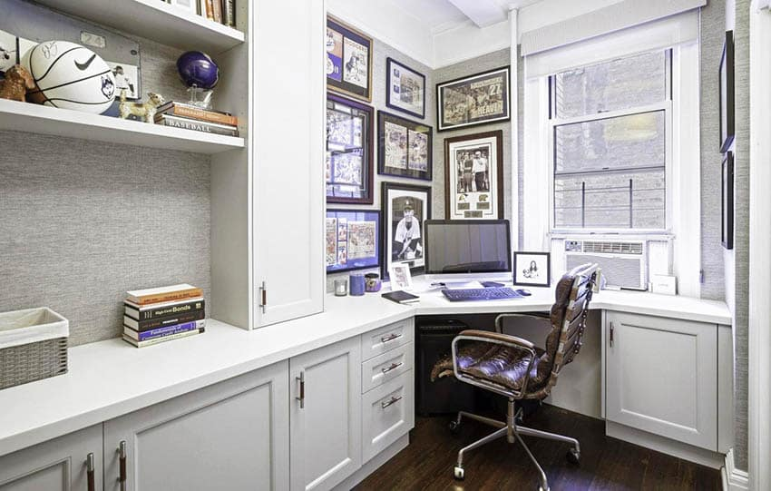 Office with corner built in desk and cabinetry