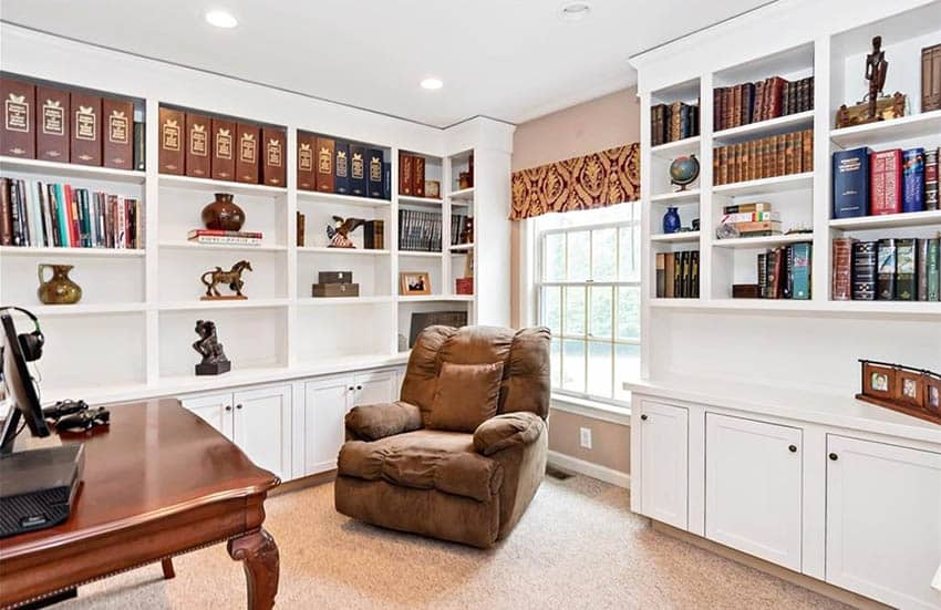 Office with floor to ceiling built in cabinets shelving