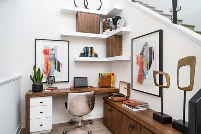 Under stairs home office niche with desk cabinet shelving