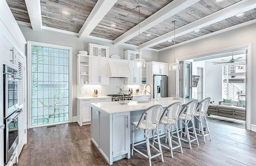 Beautiful kitchen with white cabinets wood plank ceiling and white beams