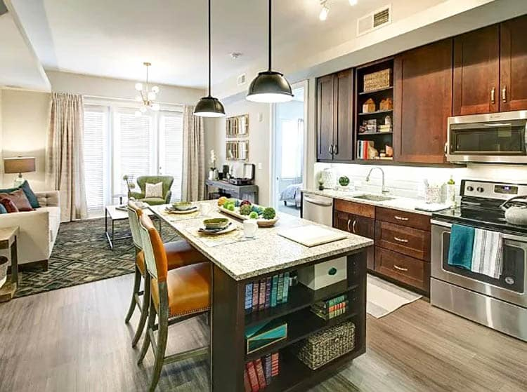 Kitchen island with built in bookshelves for cookbooks