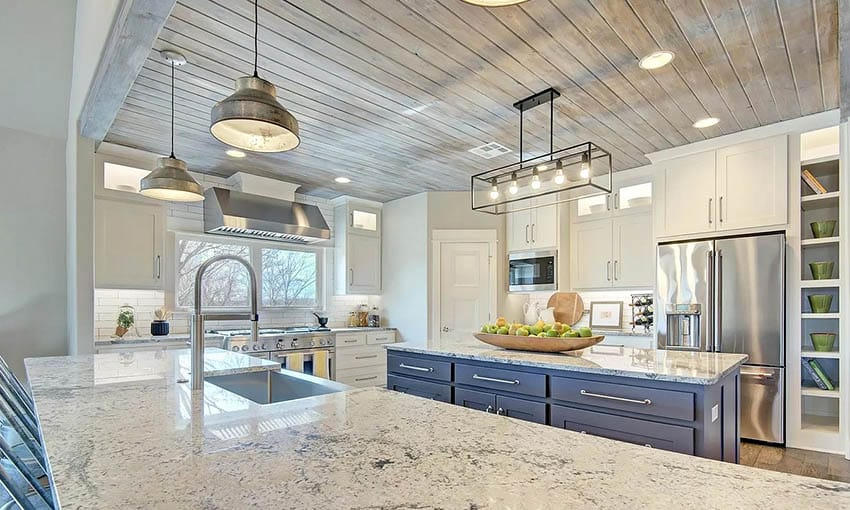 Kitchen with tongue and groove wood ceiling white cabinets blue island
