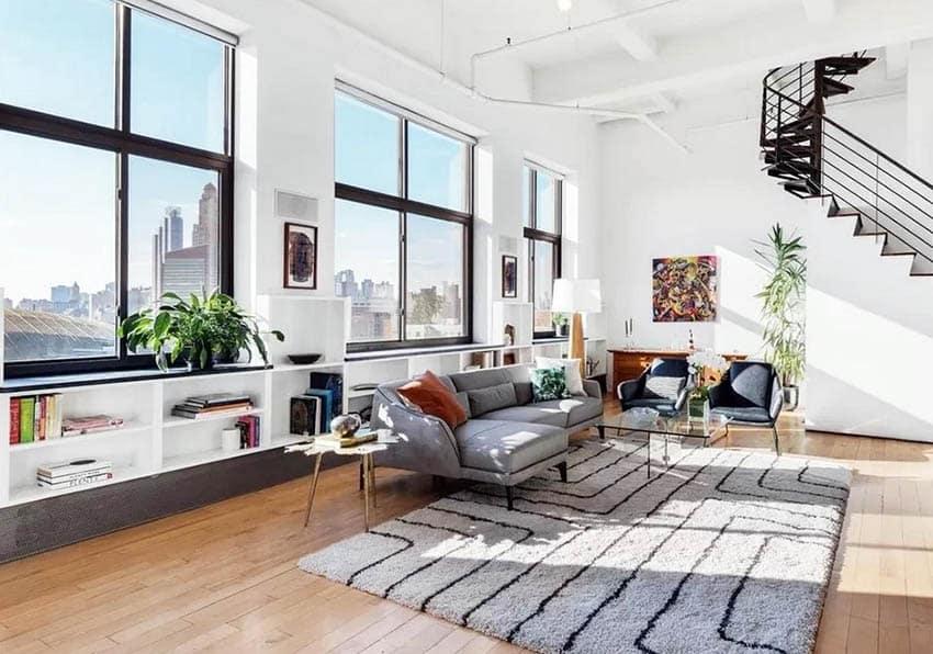 living room with long built in bookshelves below window