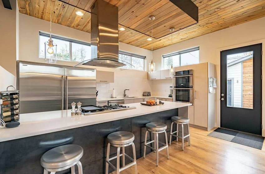 Modern kitchen with wood ceiling