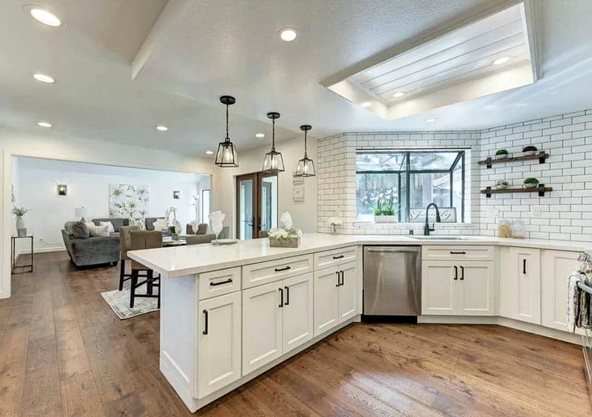 Renovated kitchen with drop ceiling to wood accent ceiling design