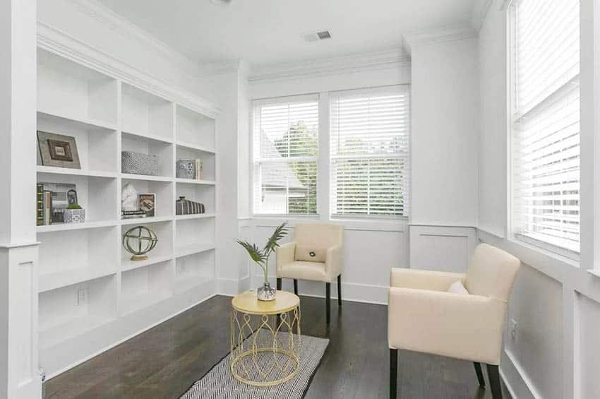 Room with white built in bookshelves