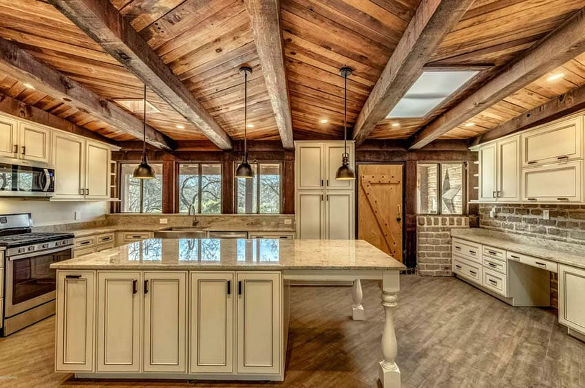 Rustic kitchen with wood plank ceiling and distressed cabinetry