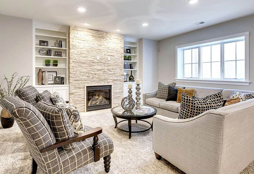 Transitional living room with built in bookshelf and stacked stone fireplace