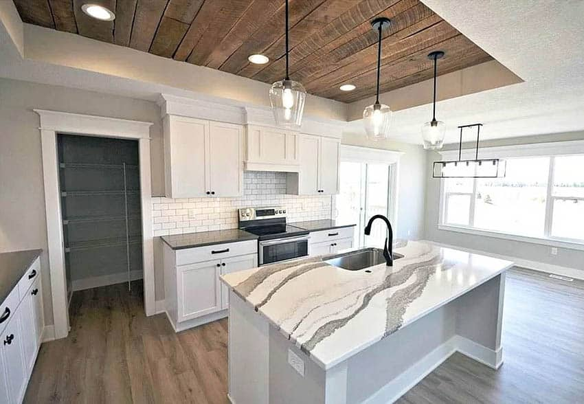White kitchen with rough plank accent ceiling
