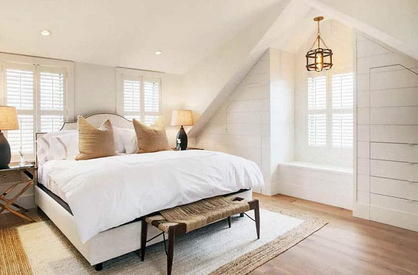 Bedroom with area rug underneath shiplap drawers