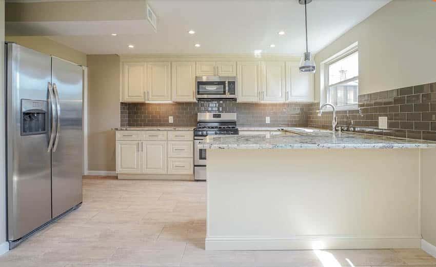 beige-kitchen-cabinets-and-beige-wall-paint-brown-backsplash-tile