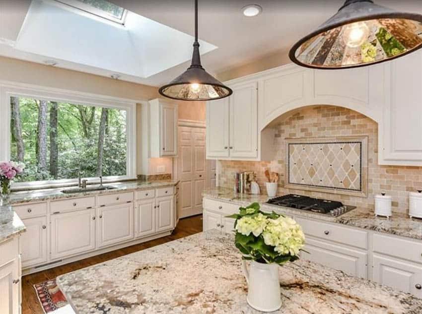 beige-kitchen-design-with-brown-granite-countertops