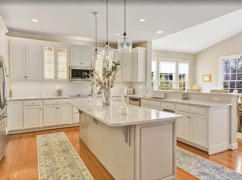 kitchen-with-beige-cabinets-tile-backsplash