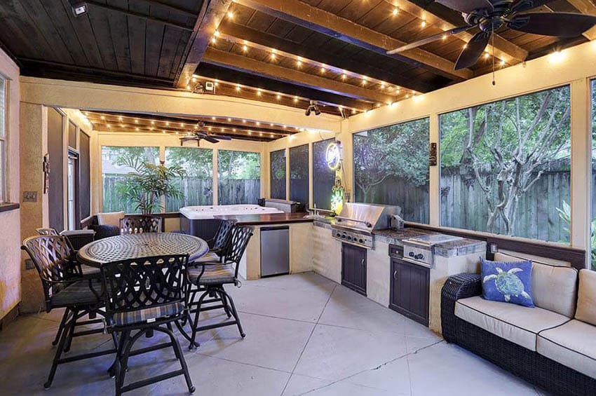 Backyard patio enclosure with outdoor kitchen and dining table