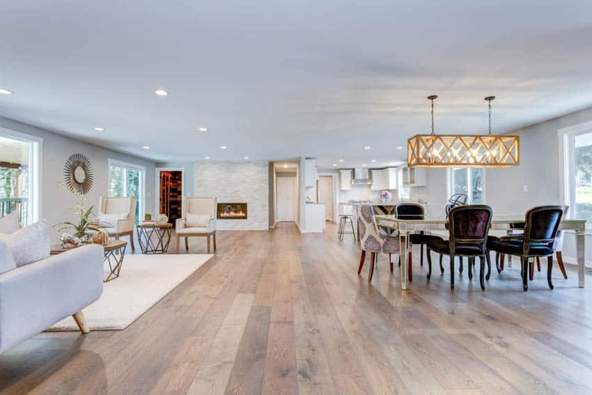 Combined space for living room and dining room with wood floors