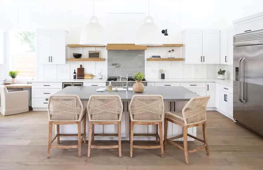 Staged contemporary kitchen with white cabinets counters gray counter island
