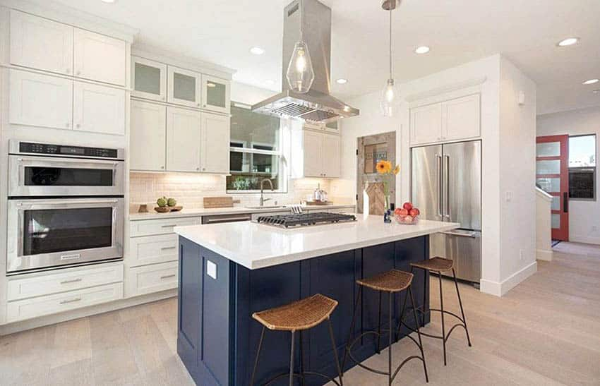 Contemporary kitchen with wood pantry door