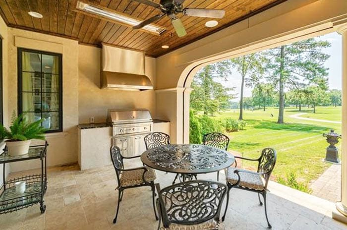 Covered patio with limestone tile flooring