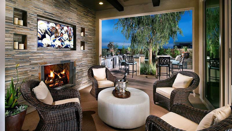 Covered patio with outdoor living room stacked stone fireplace