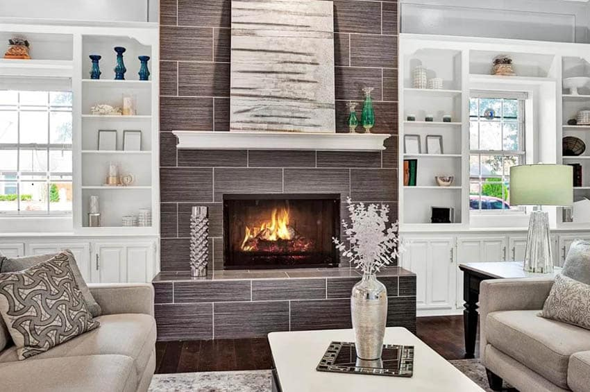 Custom built in cabinets with tile fireplace in living room
