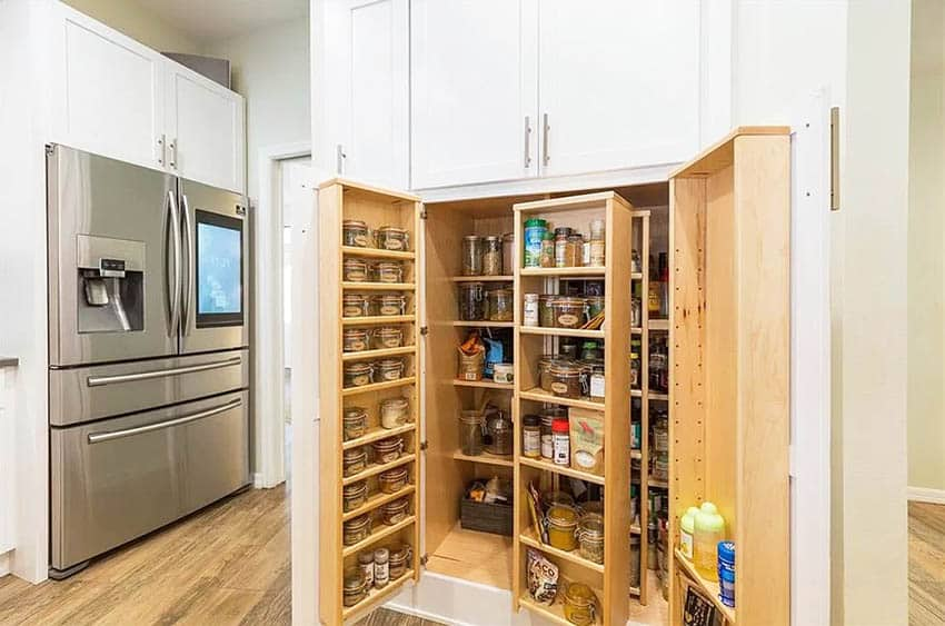 Custom cabinet pantry doors with spice rack and pull out shelving