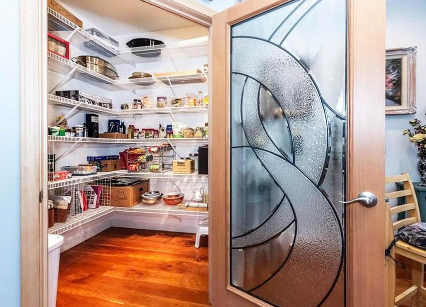 Custom kitchen pantry door with decorative glass window