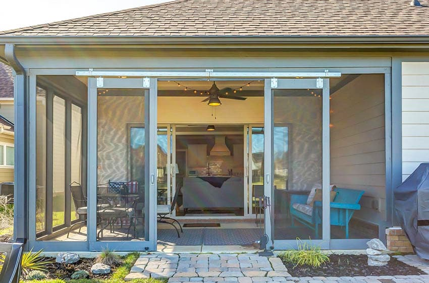 Enclosed patio design with sliding doors and screened walls