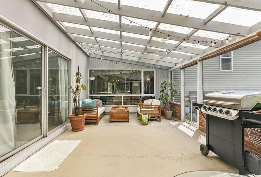 Enclosed patio with concrete flooring