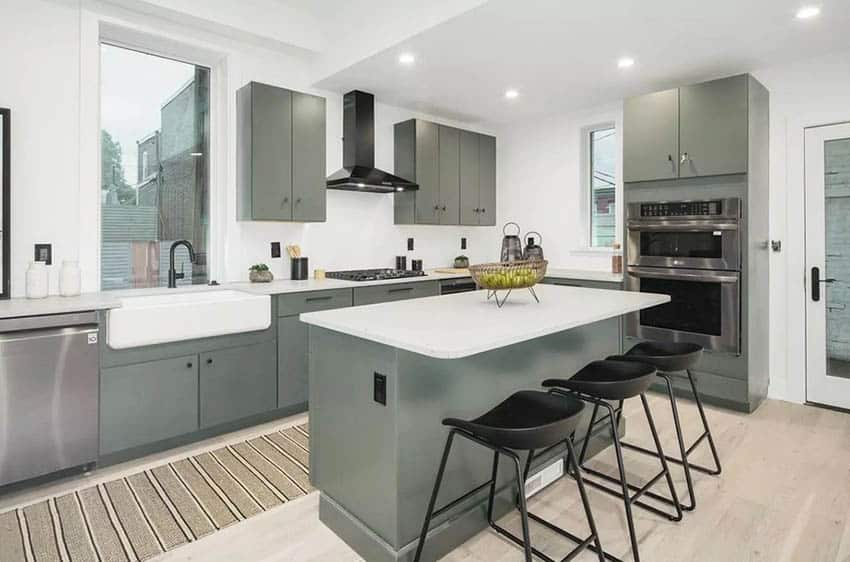 Gray cabinet kitchen with white quartz counters staging decor