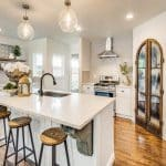 Kitchen with custom arched wood pantry door