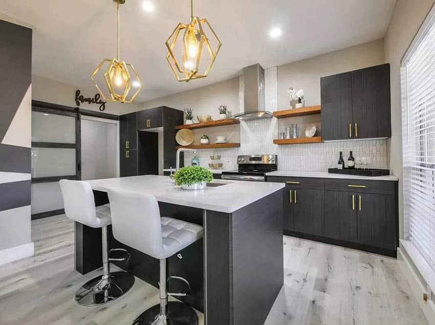 Kitchen with dark cabinets gold hardware and open shelving