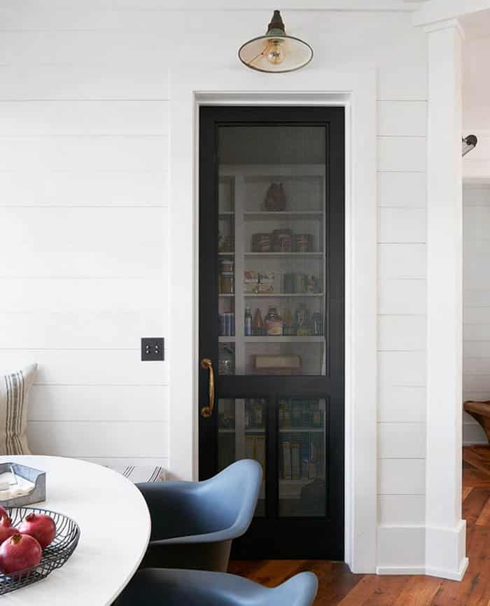 Kitchen with farmhouse screen door pantry