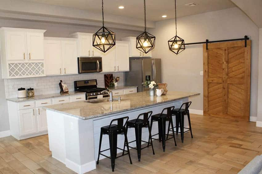 Kitchen with sliding barn door to pantry