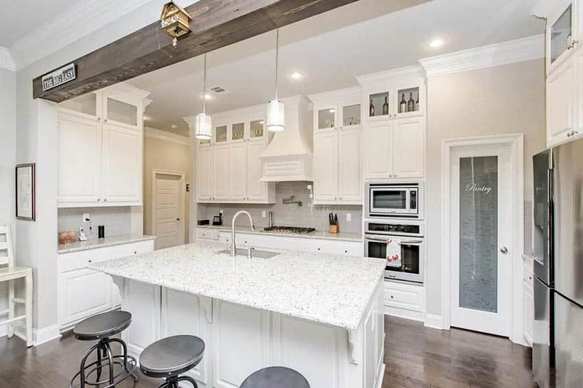 Kitchen with white cabinets glass pantry door
