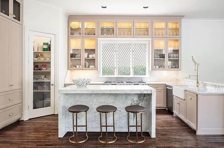 Kitchen with white pantry door with large glass window