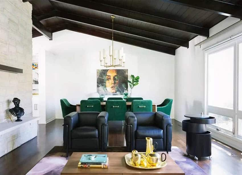 Living room with high wood vaulted ceilings and chandelier