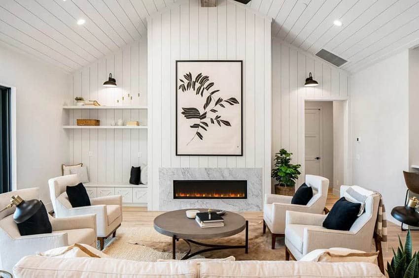 Living room with shiplap vaulted ceiling gas fireplace